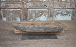 Antique wooden boat on stand
